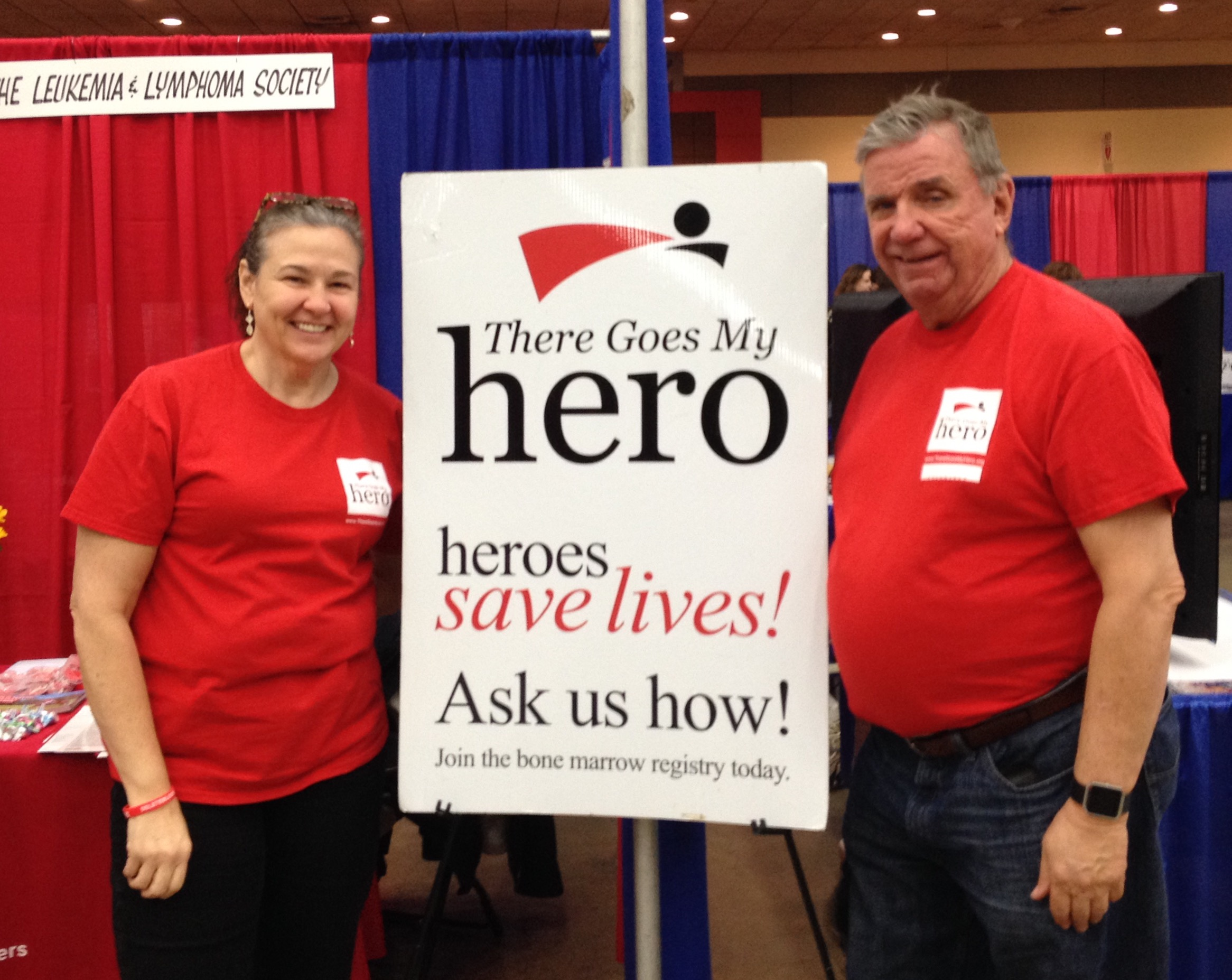 Mike's mom and dad volunteering at a bone marrow donor registry drive.