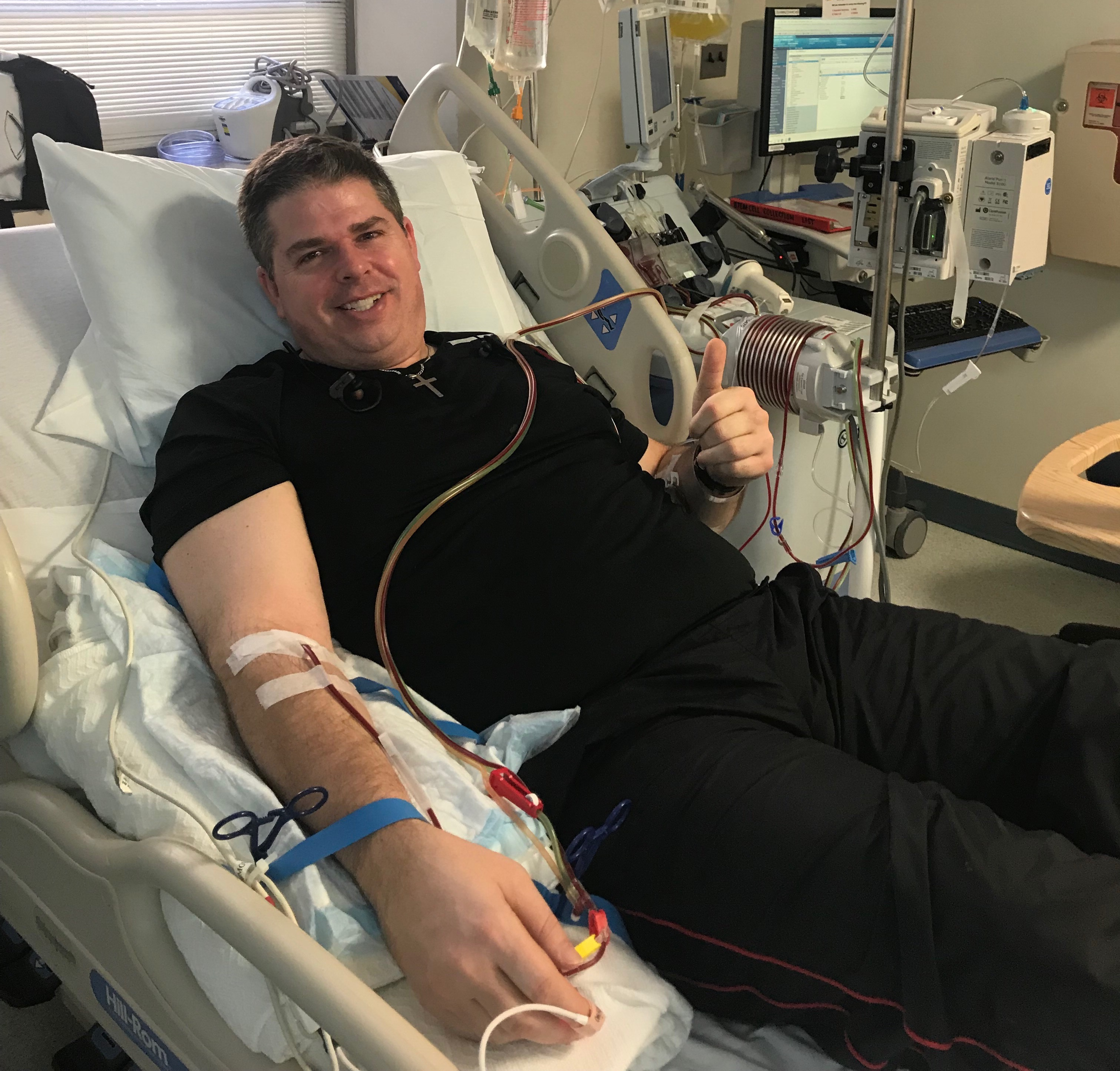 Luke Harlan donating stem cells to a blood cancer patient.